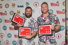 Marathon celebrates its best - A man holding a sign posing for the camera - Florida Keys