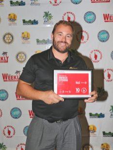Marathon celebrates its best - A man holding a laptop - Florida Keys