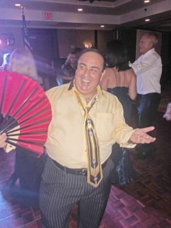 KWPD Records Clerk Emilio Monteguedo not only tears up the dance floor, but keeps everyone cool with his pretty red fan.