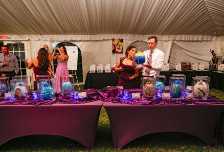 Kelli and Tyler Bennett check out a painted pumpkin during a silent auction for the second annual Photo by Doug Finger