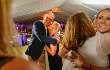 Purple Pumpkin Gala - A couple of people that are talking to each other - Wedding reception