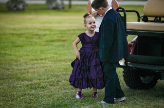 Purple Pumpkin Gala - A little girl that is standing in the grass - Founders Park