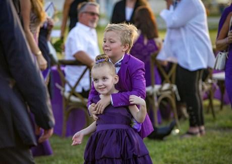 Purple Pumpkin Gala - A little girl holding a football ball - Founders Park