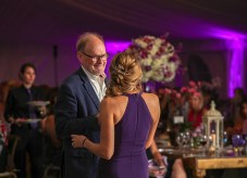 Dr. Alan Percy, a pediatric neurologist specializing in Rett syndrome, passes the mic to Michelle Bennett after speaking. Photo by Doug Finger