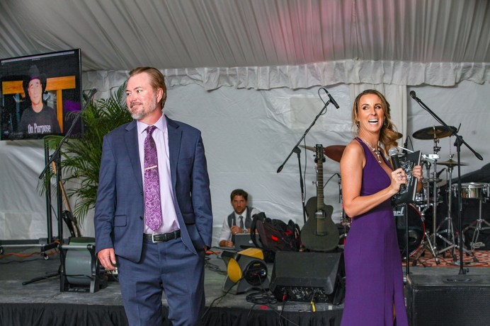 Travis and Michelle Bennett, at center, emcee during the second annual Purple Pumpkin Gala at Founders Park Saturday, October 6, 2018. The gala raises money to fight Rett Syndrome and is organized by Bennett's for their daughter Stella, 5, who was diagnosed with Rett when she was two. Photo by Doug Finger