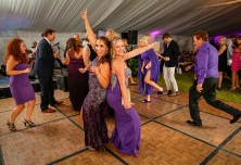 Purple Pumpkin Gala - A group of people standing in front of a crowd - Wedding reception