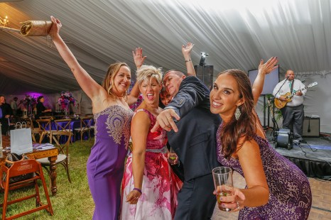 Purple Pumpkin Gala - A group of people posing for the camera - Wedding reception