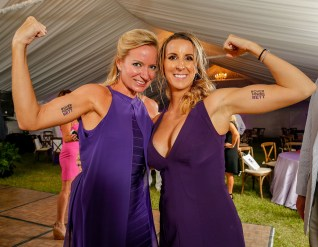 State Rep. Holly Raschein, at left, and Michelle Bennett, at right, pose together, showing off matching, temporary tattoos. Photo by Doug Finger