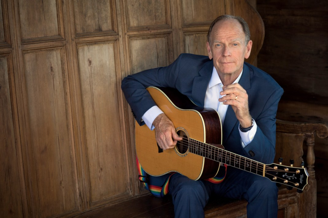 Livingston Taylor Plays the Key West Theater - Livingston Taylor holding a guitar - Livingston Taylor