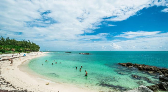 Key West Considers Sunscreen Ban - A group of people on a beach near a body of water - Fort Zachary Taylor