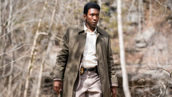 NOW TRENDING: OUR WEEKLY PICKS ON ALL THINGS ENTERTAINMENT - Mahershala Ali wearing a suit and tie standing next to a forest - Mahershala Ali
