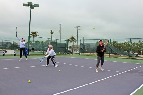 Islamorada tennis team headed to state championship - A group of people on a court with a racket - Soft tennis