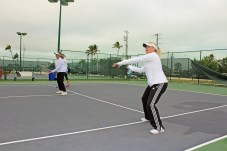 Islamorada tennis team headed to state championship - A person with a racket on a tennis court holding a racquet - Soft tennis
