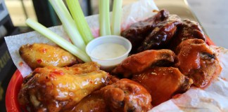 Hot pizza, saucy wings at Key Largo pizzeria - A plate of food - Kai yang