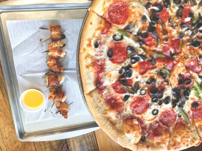 Key Colony Beach has new pizza place - A pizza sitting on top of a table - California-style pizza