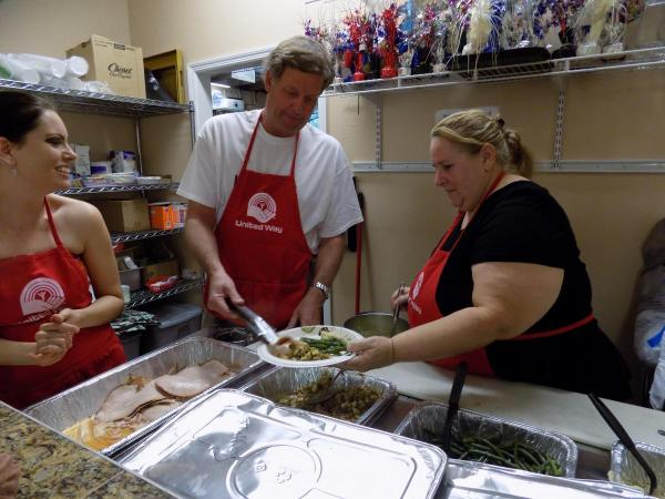 STRUGGLING TO SURVIVE - A group of people preparing food in a kitchen - United Way of the Florida Keys