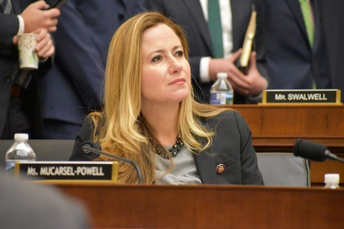 Notes from the Hill: Rep. Debbie Mucarsel-Powell gives the Weekly a report on the action in D.C. - A woman talking on a cell phone - Debbie Mucarsel-Powell