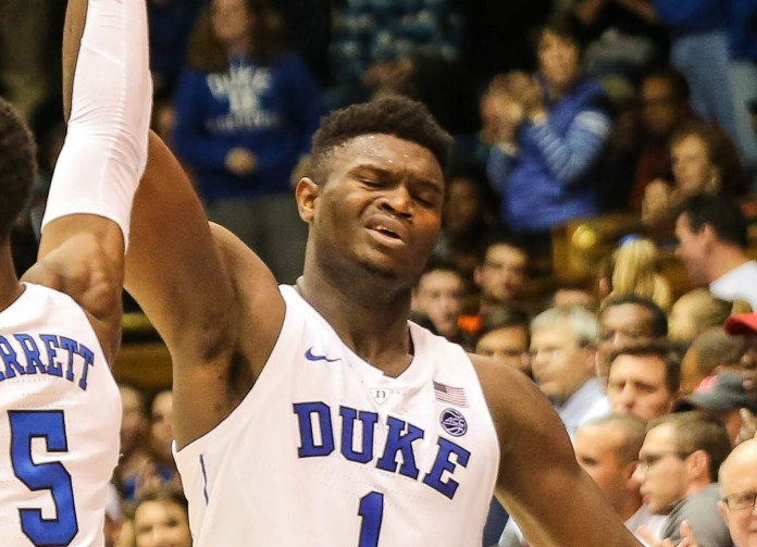 "Our Top 10 ""DONTS"" for Your 2019 NCAA Basketball Tournament - A baseball player holding a ball in front of a crowd - Zion Williamson"