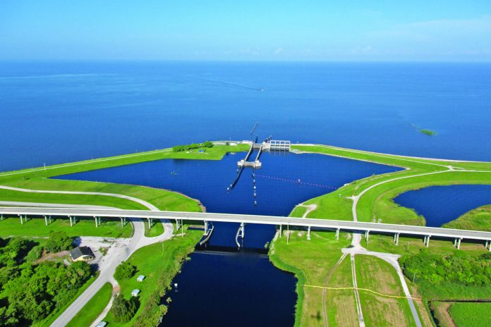 OKEECHOBEE lake levels – Army Corps of Engineers hosts meet in the Keys - A bridge over a body of water - Lake Okeechobee