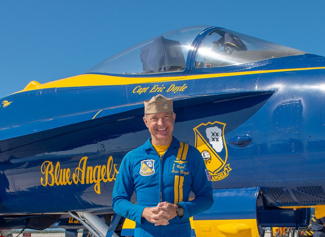 Exclusive Interview with a Blue Angel - A man standing in front of a plane - Blue Angels