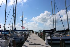 HIGH ADVENTURE - A boat is docked next to a body of water - Florida National High Adventure Sea Base, Boy Scouts of America
