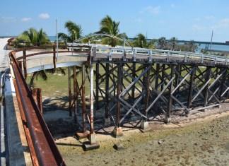 EXACT REPLICA – Pigeon Key's Wooden Bridge undergoing extensive rehabilitation. - A bridge over a body of water - /m/083vt