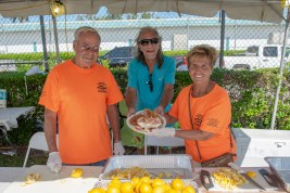 Volunteers Dick Wuertz, left, Chuckie Burdo and Toni Appell prepare fish and shrimp. Combined they have 31 years of volunteering at the festival.