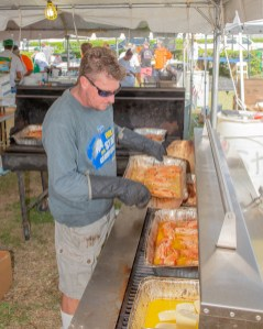 Scott Bruno keeps the estimated 2,500 pounds of lobster cooking.