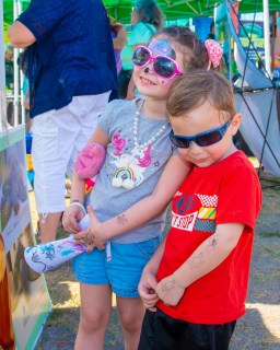 4-year-old Ava and 3-year-old Cole MacDonald of Marathon like the Turtle Hospital tent.