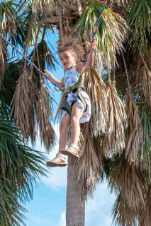 Isabella Ortiz enjoys the bungie jumping — tree high! — on the trampoline.