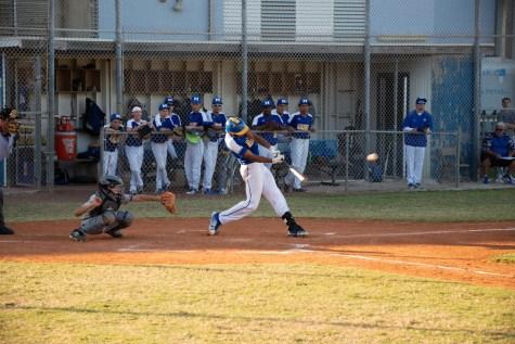 Marathon High baseball team begins season - A baseball player swinging a bat at a ball - Baseball