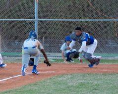Dolphin catcher Jayden Bruland and Hawks runner Nathaniel Vincent charge for home plate. Vincent was called safe.