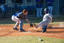 Catcher Cole McDaniel lays down a tag on the Doctor's Charter baserunner.
