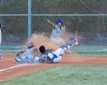 Marathon High baseball team begins season - A batter catcher and umpire during a baseball game - Pitcher