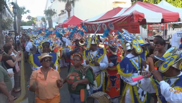 The Good, the Bad, the Funky: The Goombay Story - A group of people standing in front of a crowd posing for the camera - Junkanoo
