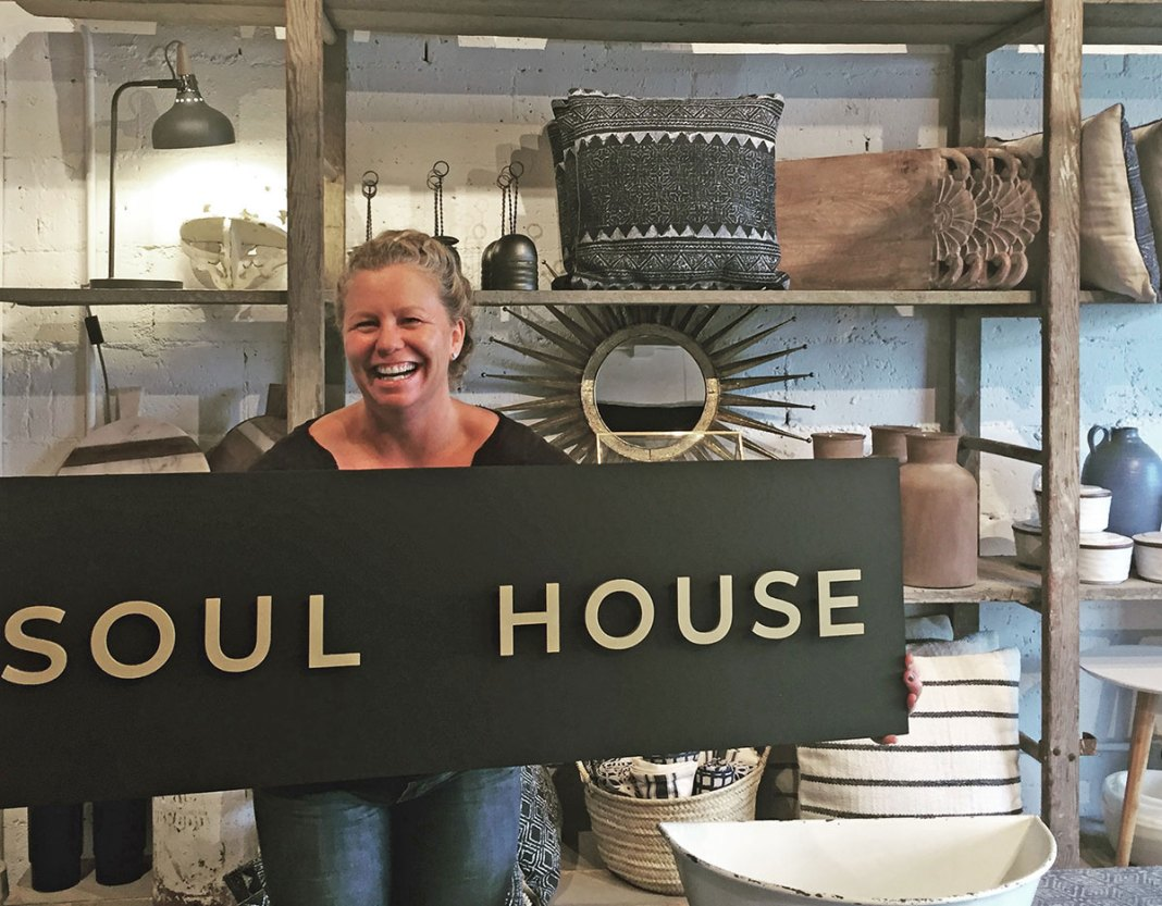 Soul House Collaborative Grand Opening - A person holding a sign - Key West