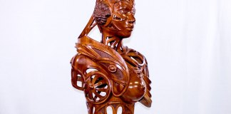 Big Wood this Weekend: Woodworking fest takes town - A close up of a gold statue - Wood