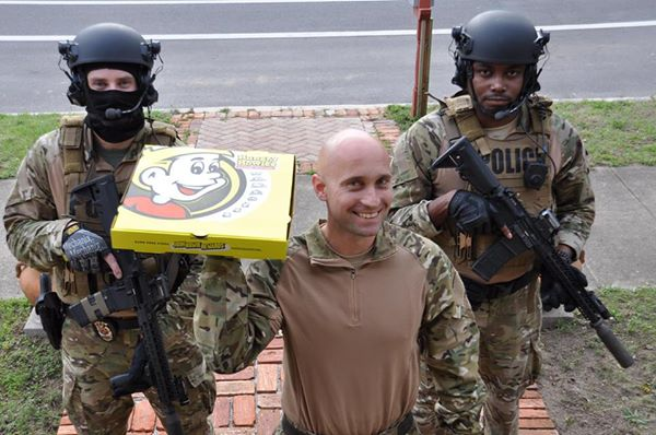 Top Ten REAL Florida Man Headlines - A group of people in uniform - Pizza