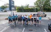 Cyclists go 125 miles to support children's shelter - A group of people standing in a parking lot - Road bicycle racing