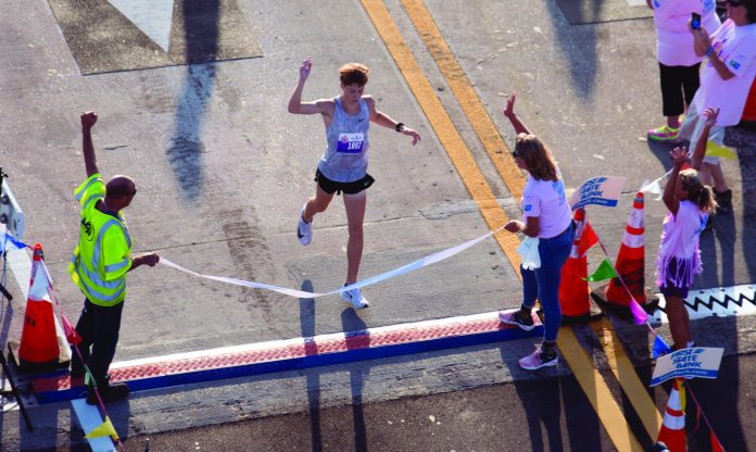 Second Marathon teenager to win 7MBR in two years - A group of people walking down the street - Marathon