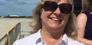 Linda Russin made the airwaves personal - A woman wearing sunglasses posing for the camera - Sunglasses