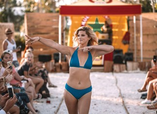 Two-day party features swimsuit fashion show and axe throwing - A group of people on a beach - Keys Cable Park
