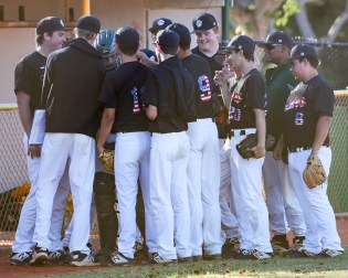 Coral Shores' baseball team meets as a group before the game against Palmer Trinity. AUSTIN ARONSSON/Keys Weekly