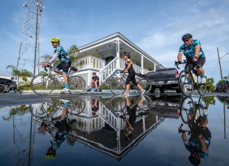 Cyclists go 125 miles to support children's shelter - A group of people jumping in the air - Bicycle