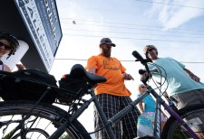 Steve Troeger, at center, owner of All Keys Cycle, checks out bikes during a stop at Ocean Sotheby's International Realty in Islamorada. At right are Florida Keys Children's Shelter Chief Development Officer Jennifer McComb and team support member Steve Molnar.