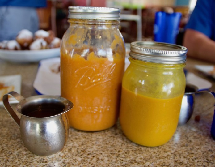 The Brotherhood Of Barbecue: The Dirty Pig is now open in Key West - A close up of a glass of orange juice - The Dirty Pig