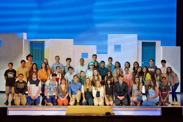 Mamma Mia' comes alive at MHS this weekend - A group of people posing for a photo - Mamma Mia!