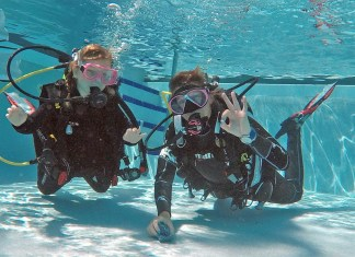 DiveN2Life trains a generation of gifted, scientific divers - People swimming in a body of water - Scuba diving