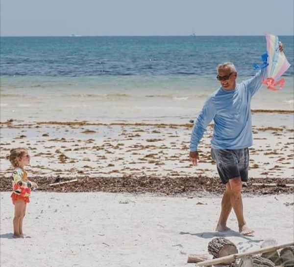 Barefoot Doctor Stan Sack Explores the Uptick in Autism - A person standing on top of a sandy beach - Beach