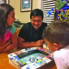 ANDREW TSANG enjoys some quality time over a game of Monopoly with his children.